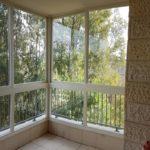 Остекление балкона с раздвижными окнами